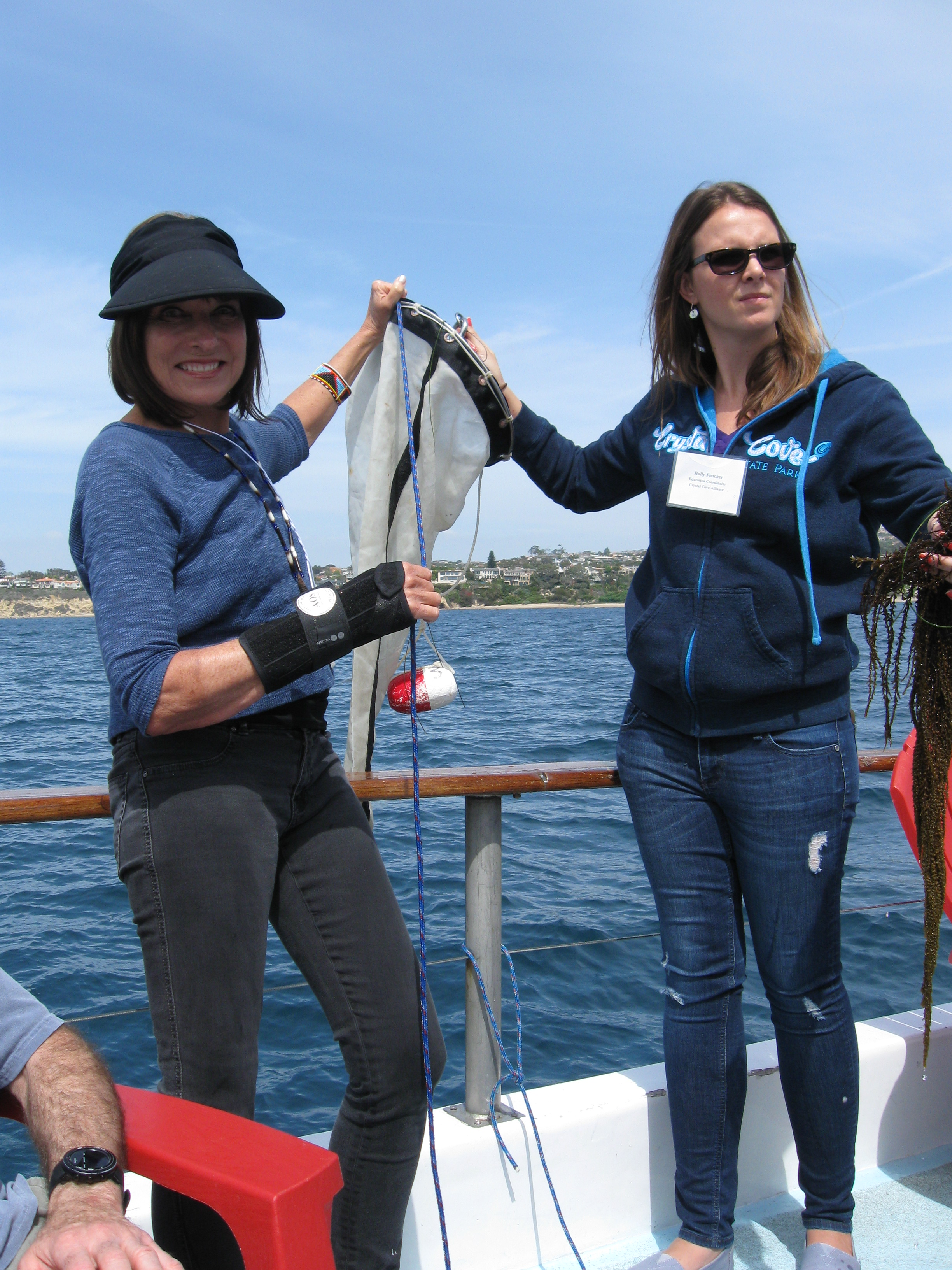Board member Patricia Twitty helps to bring in a plankton catch.